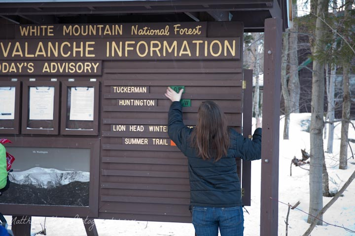 A woman updating the avalanche forecast